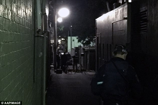 Goodlet Lane in Surry Hills (pictured) was closed while police examined the scene of the raid