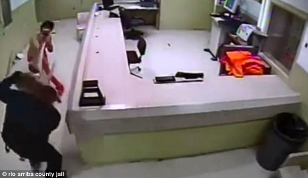 Newly released footage shows Damian Herrera, 21, brazenly trying to escape jail by using a flashlight to attack  guards in Rio Arriba, New Mexico, on July 15
