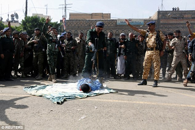 As a crowd of thousands watched, one soldier fired shots throughMaghrabi's back, killing him