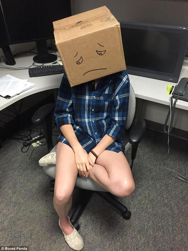 Workers who ask 'stupid questions' are forced to wear the 'box of shame' in this office