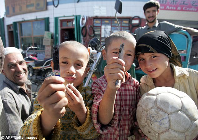 Young Uyghur boys pose for a photo in Hotan, China's Xinjiang province (File photo)