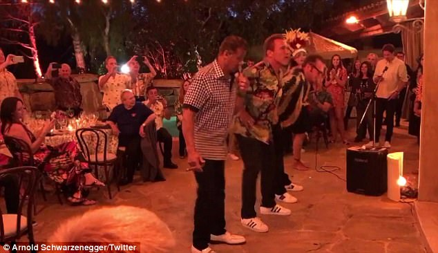 Aloha!During the Hawaiian festivities, the former California Governor received hula lessons alongside his action rival Sylvester Stallone and his True Lies co-star Tom Arnold