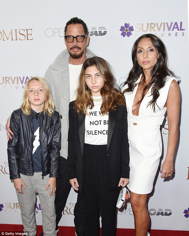 The rocker was snapped with (from left to right) son Christopher, 11, daughter Toni, 12, and widow Vicky Karayiannis at an NYC premiere in April