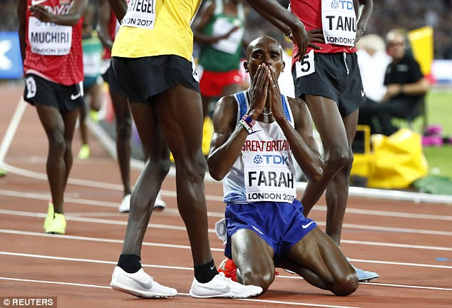 The runner collapsed to the ground on his knees as he celebrates clinching 10,000m gold