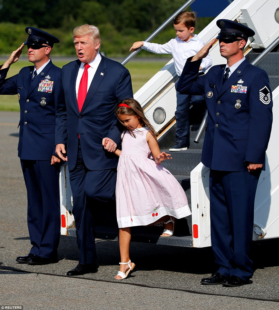 Grandpa on duty: President Donald Trump held his granddaughter Arabella Kushner's hand as he stepped off Air Force One in New Jersey on Friday afternoon