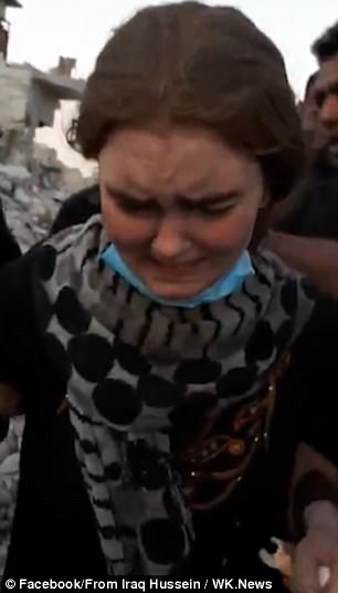 Footage shows the teenager wincing with pain and screaming as she is dragged out of the rubble while baying soldiers celebrate her capture