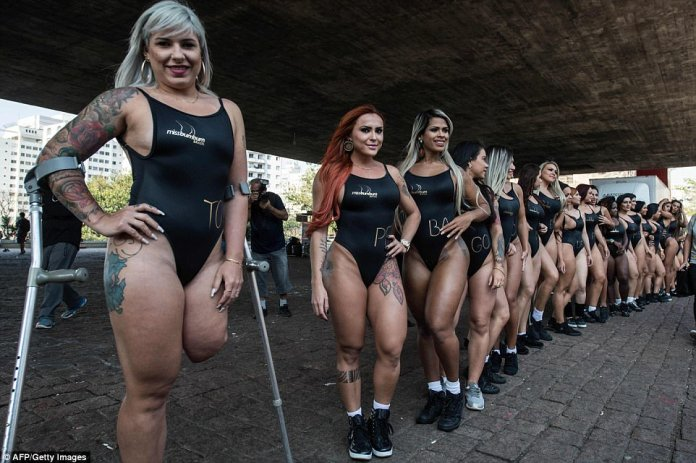 Brazilian model Rubia Machado (L), representative of the state of Tocantins and who had her leg amputated after being run over by an ex-boyfriend years ago, is one of the entrants
