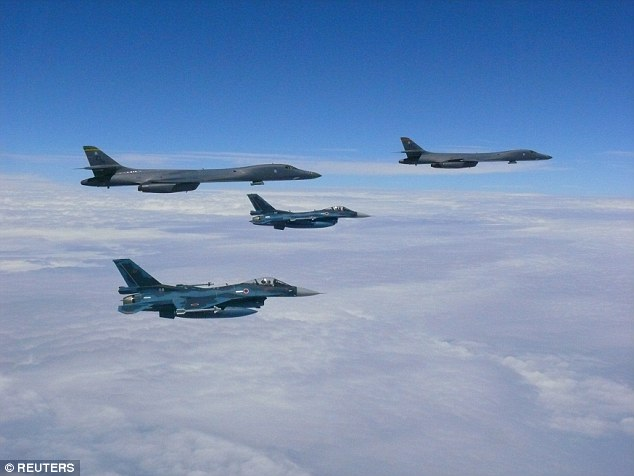 Two U.S. Air Force B-1B bombers from Guam's military base  participated in a strategic bilaterial mission with South Korea and Japan hours before North Korea threatened to strike Guam. Pictured top left and right are the two B-1B Lancer bombers and bottom left and center are Japan Self-Defense Forces F-2 fighter jets near Kyushu, Japan during the mission