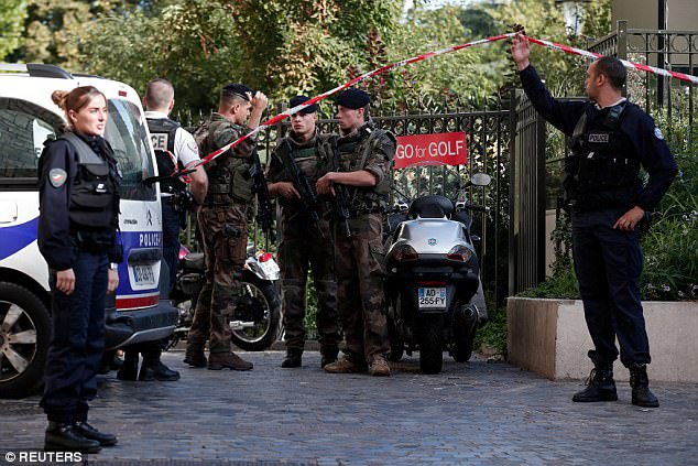 Investigation: Paris prosecutors have opened up a terror probe as police still hunt for the driver, who fled the scene in Levallois-Perret