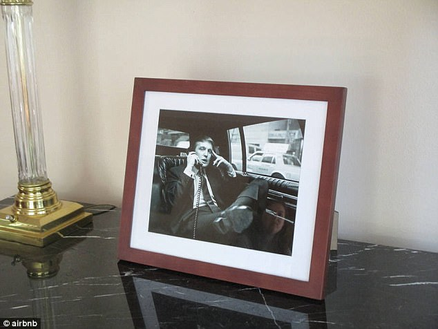 Much of the home is set up seemingly like a shrine to Trump, with framed photos of the president covering countertops