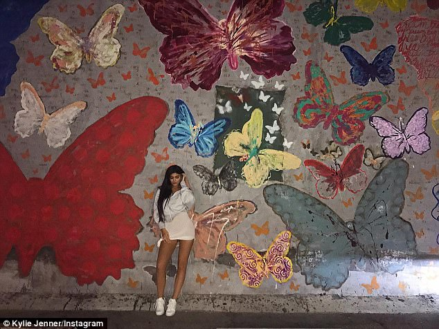 '20!'Kylie posed in her trendy look for an Instagram picture she shared in the early hours of Thursday morning