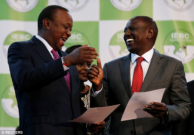 Kenyatta celebrates with Deputy President William Ruto after he was announced winner of the presidential election