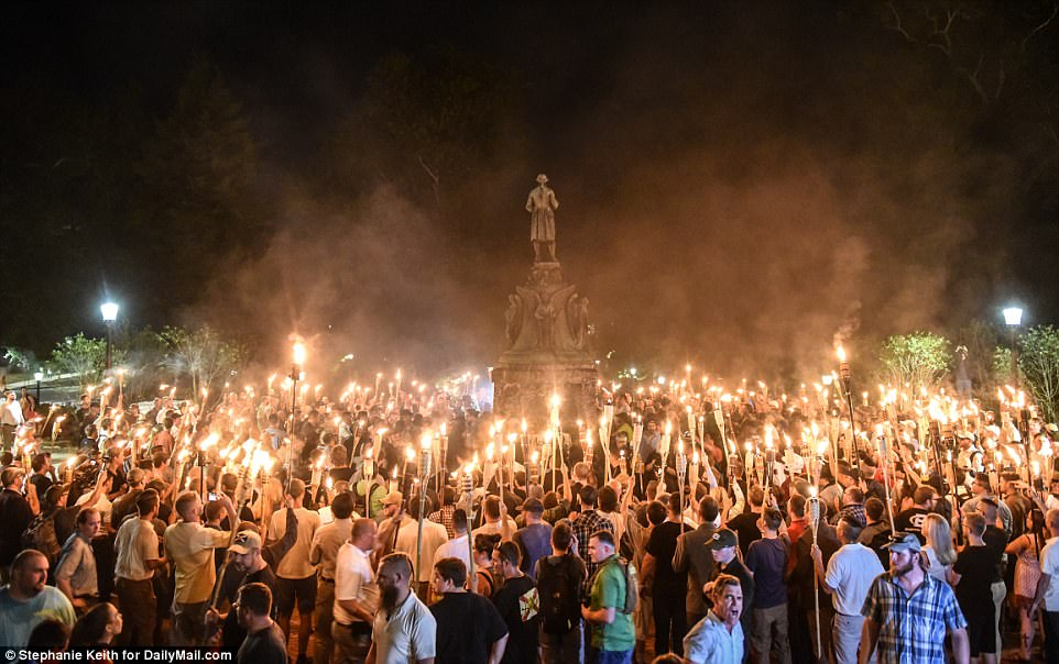 Hundreds of white nationalists marched through the University of Virginia with burning torches on Friday