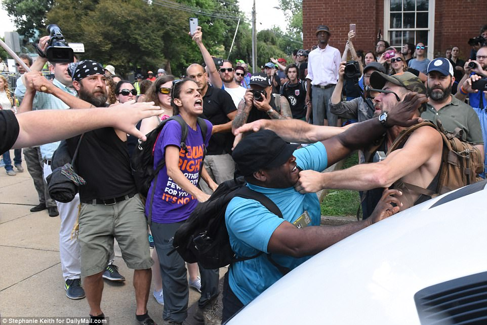 A group of white activists clash with others at the Unite the Right Rally in Charlottesville on Saturday morning
