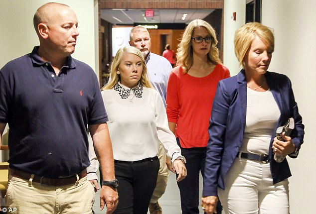 Brooke Skylar Richardson, second from left, an 18-year-old Ohio woman charged in the death of her newborn infant found buried outside her home Carlisle, arrives with her family for a pretrial hearing in Warren County Court Tuesday in Lebanon, Ohio
