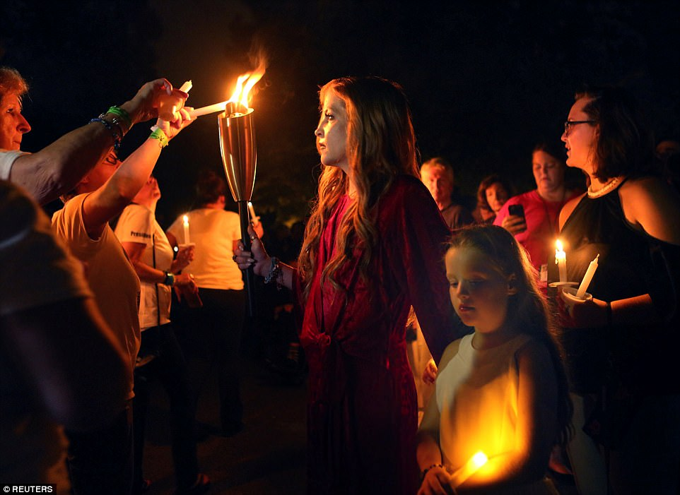 Presence: Lisa Marie was also present at the event, lighting the candles of some of the thousands of visitors that had gathered to remember her father and his impact on modern American culture