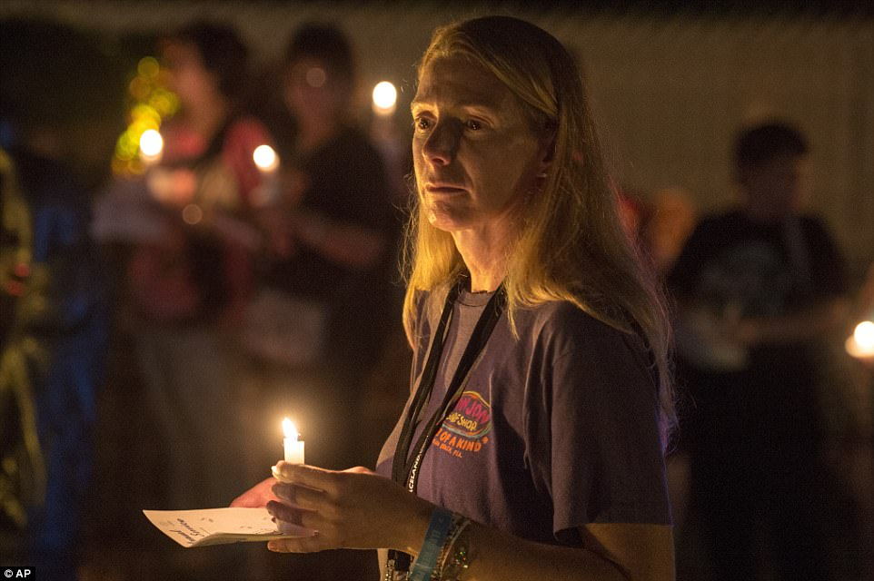 A woman participates in a candlelight vigil for Elvis Presley at Graceland in Tennessee