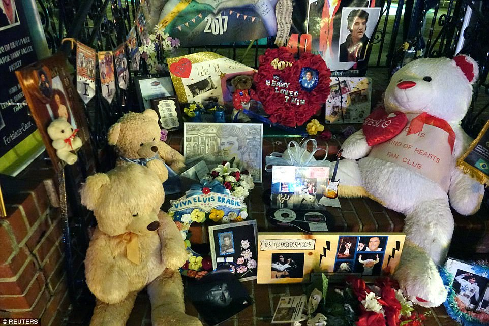Mourners left trinkets and stuffed animals in honour of the rock and roll legend at his former Graceland home
