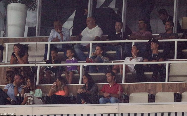 Cristiano Ronaldo (right, middle row) was forced to watch on from the stands as he began his five-game suspension