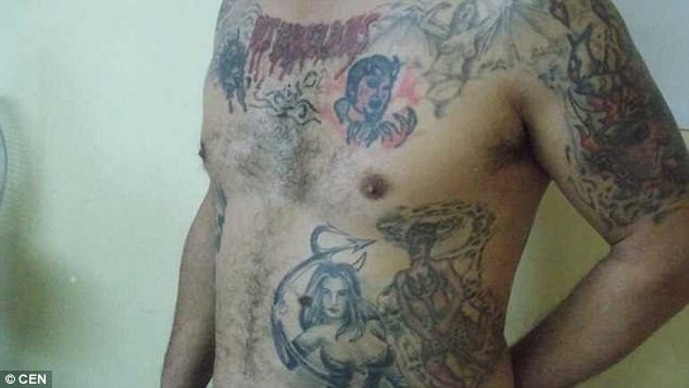 Pictured: One of the suspect's body tattoos, showing Satanist iconography