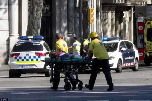 At least 13 people have been killed and dozens injured after a van ploughed into pedestrians in Las Ramblas, Barcelona's busiest tourist area. Police are still hunting two armed men who have escaped and are believed to be hiding in a nearby restaurant