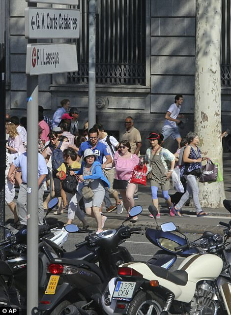 People flee after the van drove into crowds in centre of Barcelona