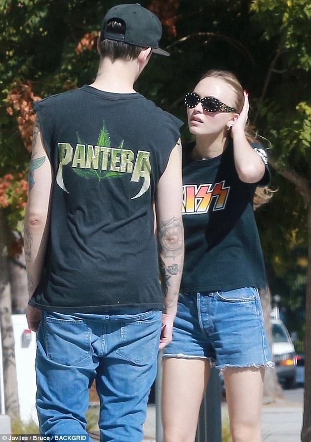 Vintage vibe: Lily-Rose, 18,paired a KISS shirt with a set of denim cut-offs. The daughter of Johnny Depp and Vanessa Paradis looked lovely with natural make-up