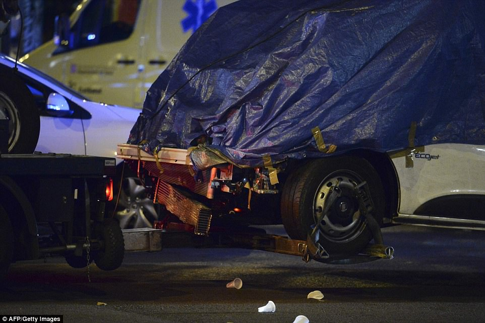 Damage: The front of the van can be seen destroyed in these images taken late last night