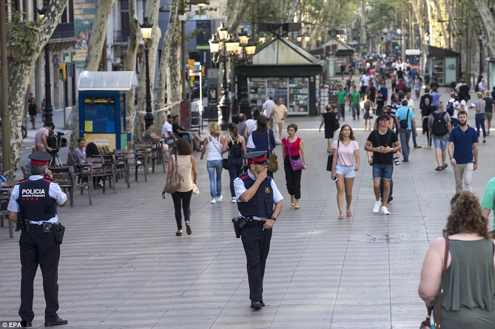 Large units of police are patrolling Los Ramblas today as tourists and local returned to the area where 13 died yesterday