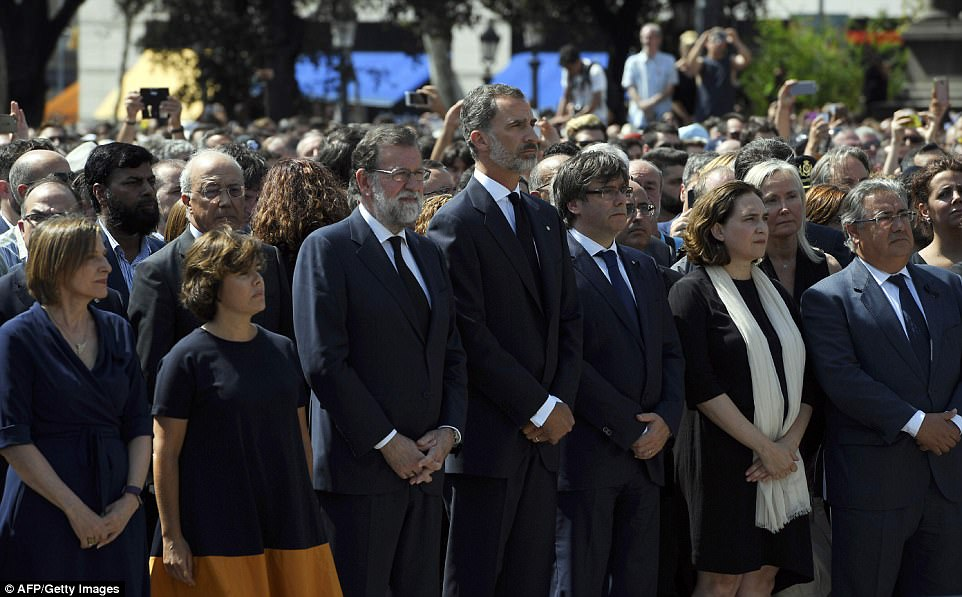 King Felipe VI (centre), Spanish Prime Minister Mariano Rajoy (to his left), and President of Catalonia Carles Puigdemont (to his right) led a minute of silence in Barcelona on Friday for the victims of the attack