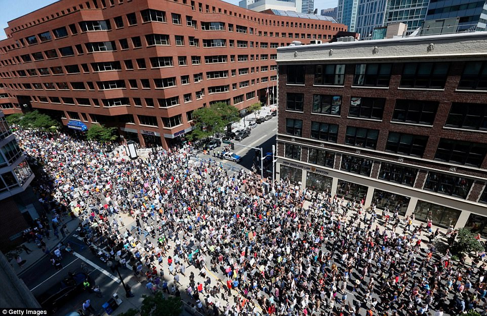 Boston braced itself for what could have been a violent day with at least 500 police officers to man the streets to keep the peace between thousands of tense people