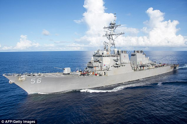 Ten sailors are missing and five have been reported injured after the USS John S McCain (pictured in June) was involved in a collision with a merchant vessel on Monday morning, the Navy has said