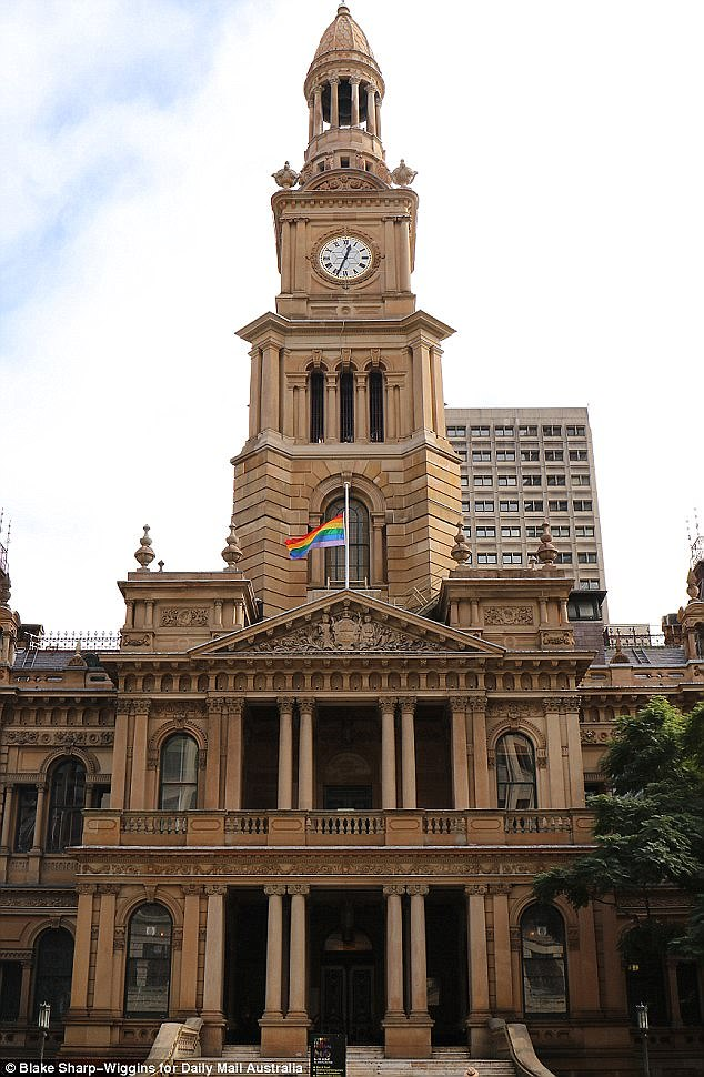 Australia is preparing for a postal plebiscite on gay marriage, and voters have until August 24 to update their details or enrol (pictured is the rainbow flag flying over Sydney's Town Hall)