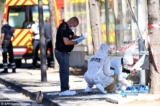 Casualties: French forensic police attend one of the bus stops hit by a man in a dark vehicle during Monday morning rush hour