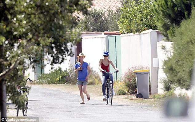Helping hand: The 18-year-old daughter of American actor Johnny Depp was spotted wobbling about on a bicycle, watched closely by her model mum Vanessa Paradis and grandmother
