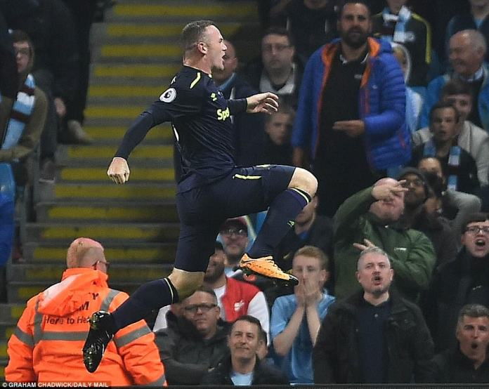 The Everton striker, clearly not a popular man at the Etihad, leaps in the air in celebration after grabbing his goal