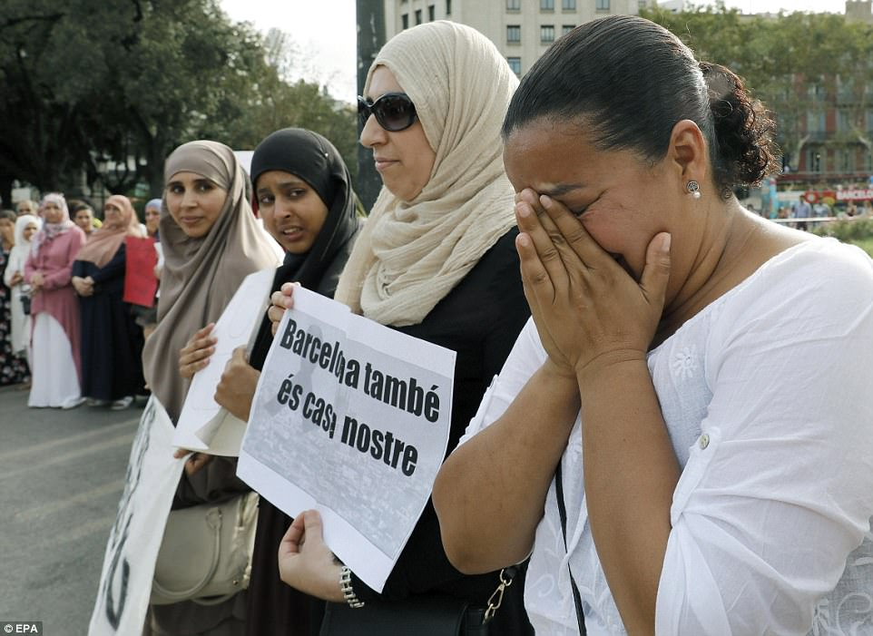 A woman cried during the emotional protest, while other people shouted slogans and held up posters in Barcelona on Monday