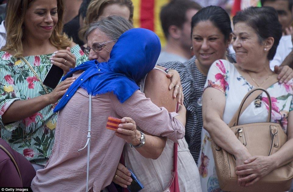 Two women hug as they mourn during a demonstration against terror attacks and solidarity with the victims of the terror attack