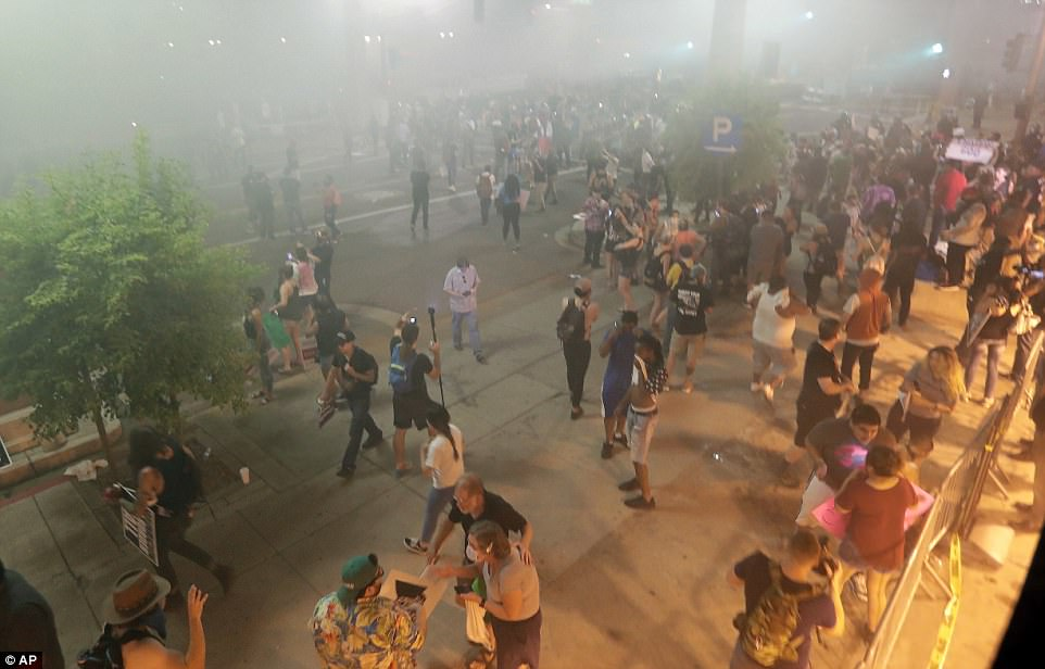 The violent scenes came after police tried to disperse crowds of anti-Trump protesters with tear gas following the rally. The anti-Trump crowd were vastly outnumbered by Trump fans