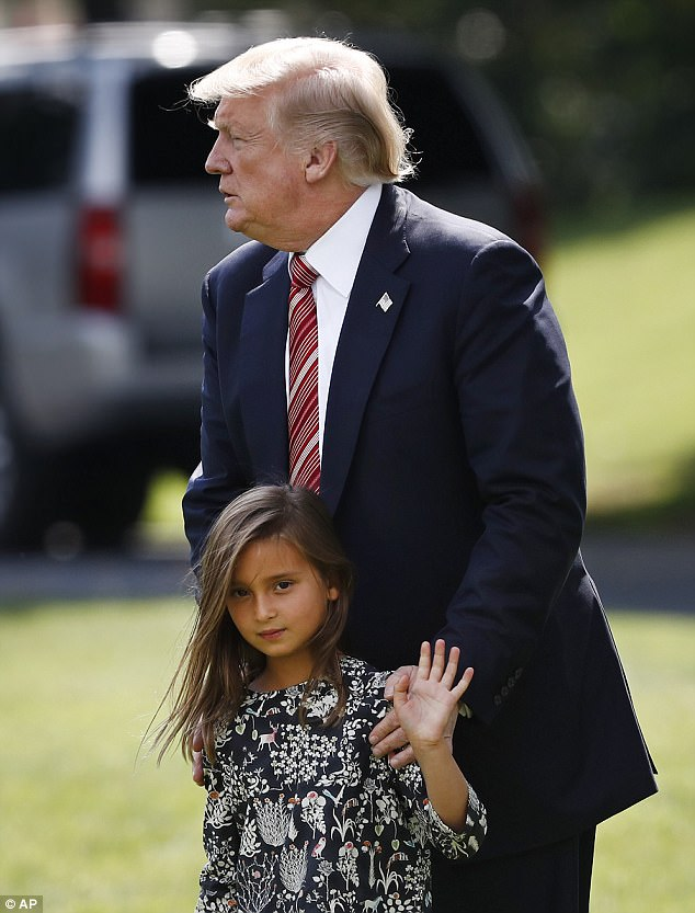 Arabella Kushner waves to reporters and she walks with her grandfather, President Donald Trump, to Marine One on Friday