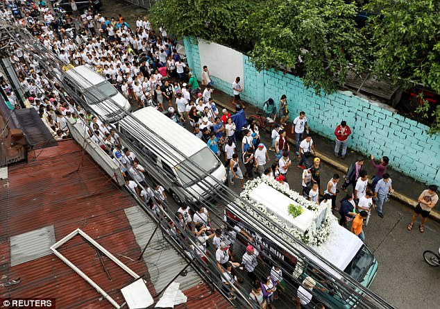 The slow-moving procession snaked through narrow streets as participants, many wearing black ribbons, carried posters that read 'Stop Killing the Poor'