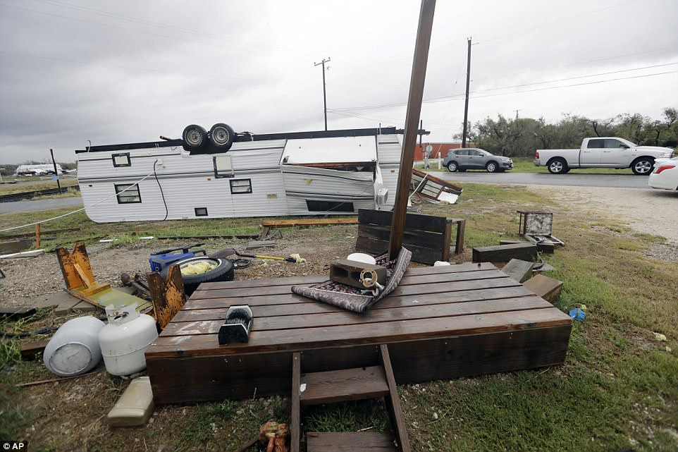 A trailer overturned and objects strewen about in the wake of Hurricane Harvey on Saturday in Aransas Pass, Texas