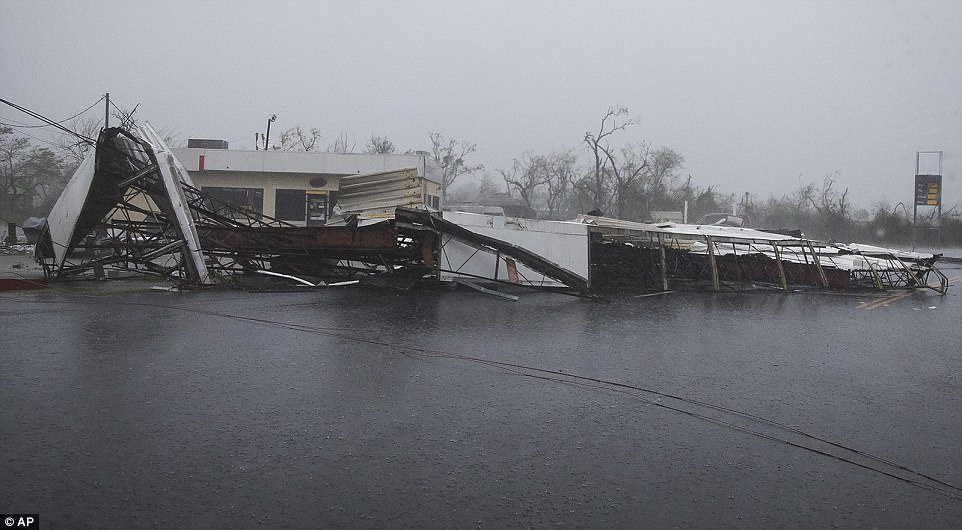The mayor of Rockport, a coastal city of about 10,000 that was directly in the storm's path, said his community took a blow 'right on the nose' that left 'widespread devastation. Pictured:A gas station's fallen awning blocks a street after Hurricane Harvey ripped through Rockport, Texas, on Saturday