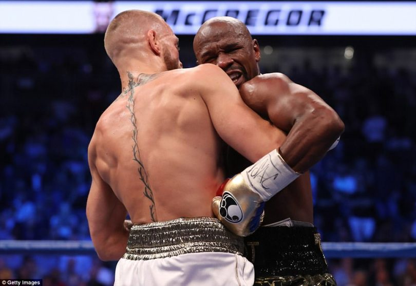 Mayweatherwent to work to head and body during round four - and McGregor was beginning to rely on time-wasting tactics