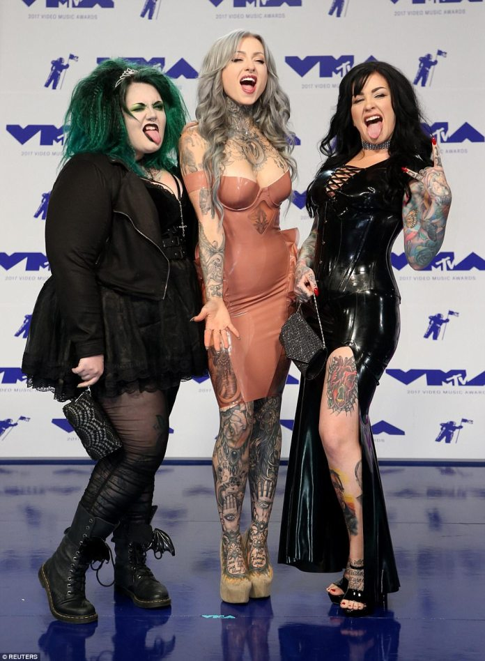 Rocking out: The cast of reality television show Ink Master: Angels flaunted their vampy style on the capet