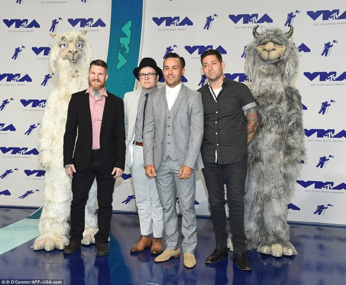 Dance, Dance: Pete Wentz posed with his band Fall Out Boy along with two mascots