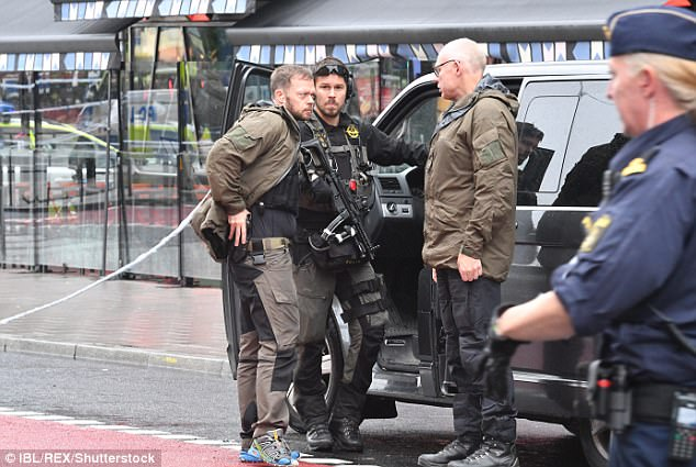 Heavily armed specialist officers descend upon Stockholm after the attack on the police officer