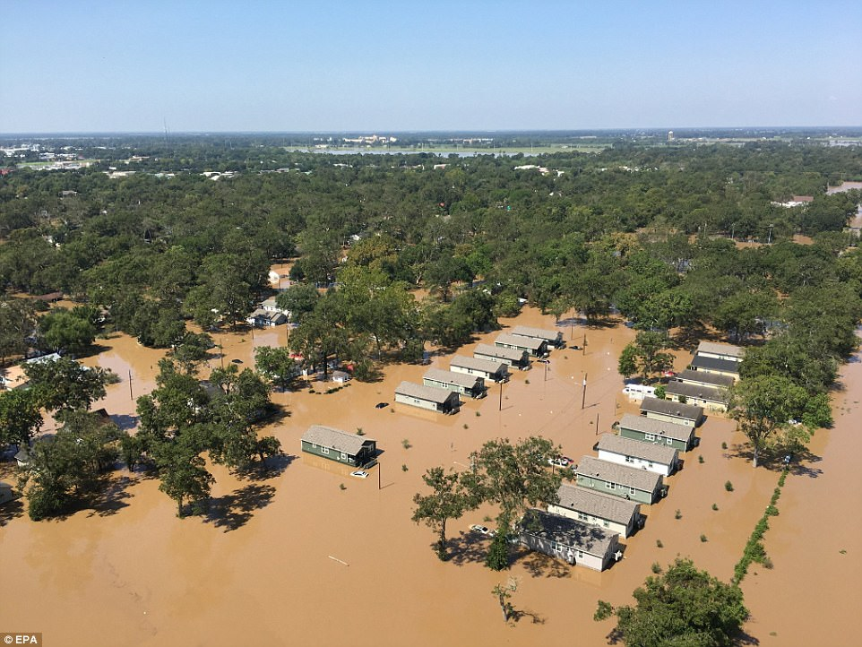 A handout photo made available by the US Coast Guard shows damage seen from a deployed Coast Guard helicopter crew surveying in response to Hurricane Harvey in Wharton, Texas on Thursday