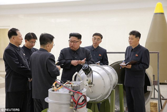 Photos released Sunday show the country's leader Kim Jong-un inspecting a hydrogen bomb that will be loaded on a new intercontinental ballistic missile