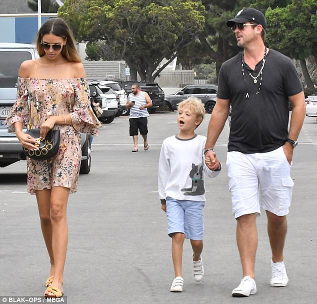 April Love Geary Covers Baby Bump In Short Floral Dress